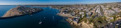 Afternoon aerial panoramic view of the Newport Harbor, skyline and Corona del Mar beach of Newport Beach, California, USA.