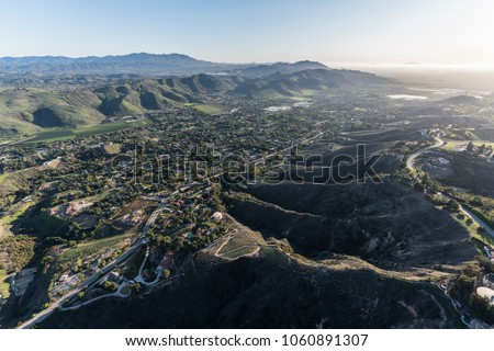 Afternoon aerial view of Santa Rosa Valley homes and hillsides in the Camarillo neighborhood of Ventura County California.
