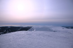 afternoon at the top of the mountain, mountain views, mountain panorama in winter, the sun is heading west, snow ice cap