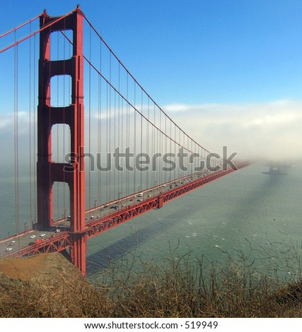 Afternoon fog obscures second tower of the Golden Gate Bridge