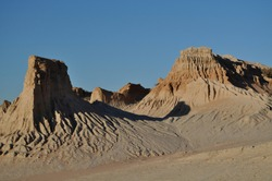 Afternoon sun on the eroded sand formations at Mungo National Park in outback New South Wales, Australia