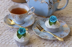 Afternoon Tea party with vintage blue tea cup, saucer and teapot - cupcakes with blue roses