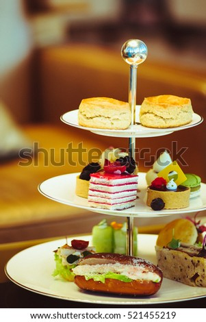Afternoon tea stand #521455219