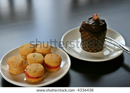 Afternoon tea with cookies and a cup cake.