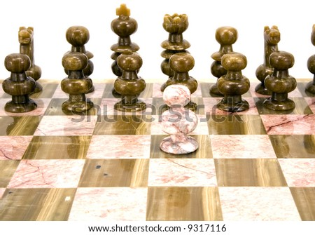 Against all odds - Chess pieces isolated on white