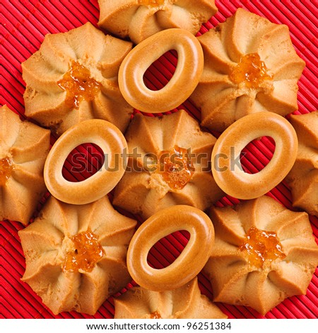 against background of pink bamboo cloth is crunchy biscuits with bagels