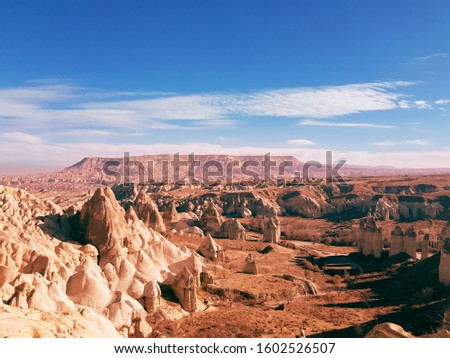 against the background of a wonderful Cappadocia volcanic valley Stok fotoğraf ©