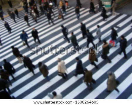 Against the background of the zebra crossing black and white lines, it blurs the busy attitude of passers-by. Showing the sense of time, Osaka, Japan                #1500264605
