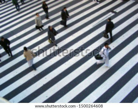 Against the background of the zebra crossing black and white lines, it blurs the busy attitude of passers-by. Showing the sense of time, Osaka, Japan                #1500264608