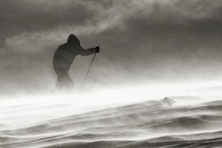 against the wind, on a ski expedition in a blizzard