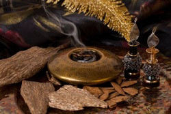 Agarwood, also called aloeswood, essential oil and incense chips
