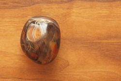 Agate striped Congo raw raw natural stone agate stone, a collection of natural stones on a background of natural wood black walnut. Beautifully crafted stone. Copy space.