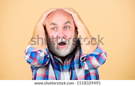 Age issues. Man losing hair. Health care concept. Male pattern baldness genetic condition caused by variety factors. Early signs balding. Elderly people. Bearded grandfather grey hair. Hair loss.