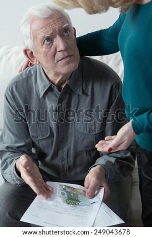 Aged afraid man looking at his bottom line