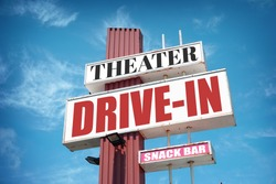 Aged and worn vintage drive-in movie theater sign