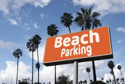 Aged and worn vintage parking sign with palm trees
