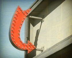 aged and worn vintage photo of arrow sign