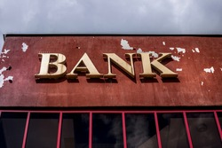 Aged and worn vintage photo of bank sign
