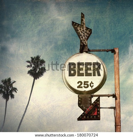 Aged And Worn Vintage Photo Of Beer Sign With Palm Trees