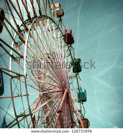 aged and worn vintage photo of carnival ferris wheel