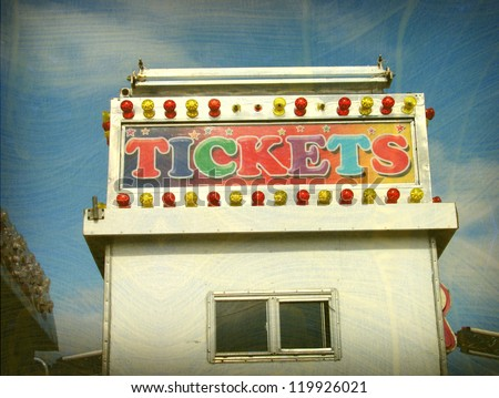 aged and worn vintage photo of carnival ticket booth
