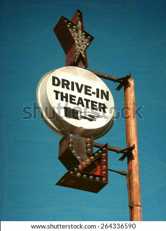 aged and worn vintage photo of drive in theater sign