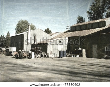 aged and worn vintage photo of farm building