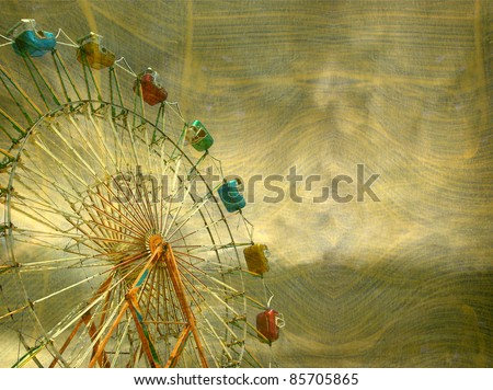 aged and worn vintage photo of ferris wheel with stormy sky