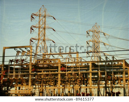 aged and worn vintage photo of high voltage power lines and transformers