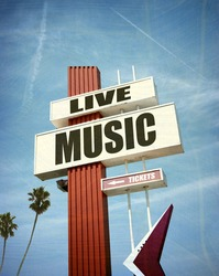 aged and worn vintage photo of live music sign