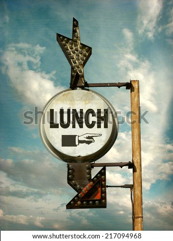 aged and worn vintage photo of lunch sign with arrow