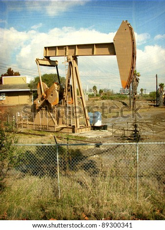 aged and worn vintage photo of  oil derrick