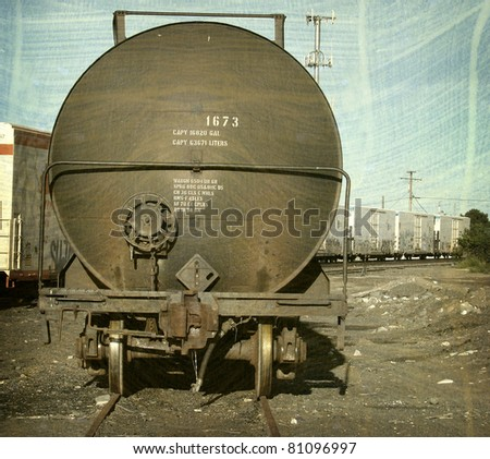 aged and worn vintage photo of old rail tanker car with room for text