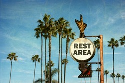 aged and worn vintage photo of rest area sign
