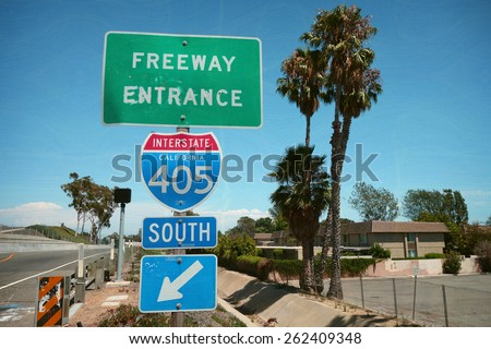 aged and worn vintage photo of southern california freeway sign