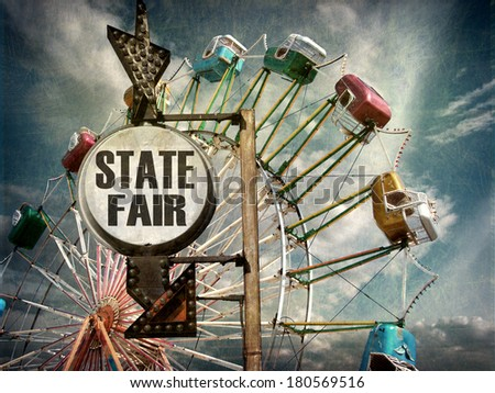 aged and worn vintage photo of state fair sign with ferris wheel
