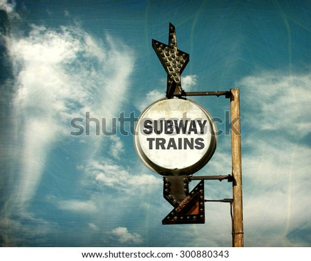 aged and worn vintage photo of subway trains sign