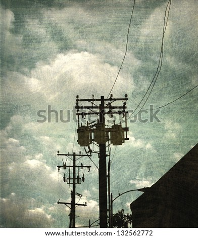 aged and worn vintage photo of urban sky with telephone pole