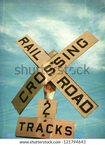 aged and worn vintage railroad crossing sign