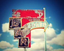 aged and worn vintage sign for a bar or tavern toned with a retro vintage instagram filter
