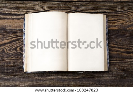 Aged blank book on wooden table, blank pages