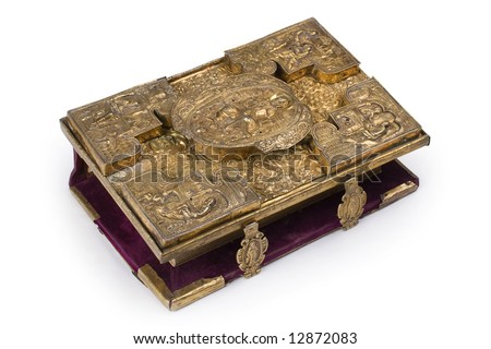 Aged book in metal framework at white background #12872083