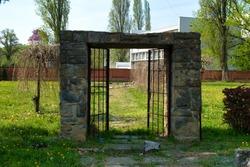 Aged brick gate of historic catholic cemetery in Novi Sad, Serbia