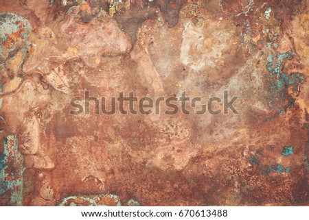 Aged copper plate texture with green patina stains. Old worn metal background. #670613488