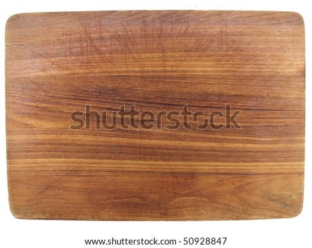 aged dark chopping board out of wood with cuts