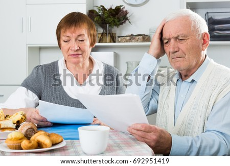 Aged family struggling to pay utility bills and rent for their apartment