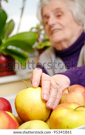 Aged female want to eat  apple