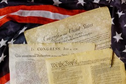 Aged historical documents Washington DC on American Declaration of independence 4th july 1776 on U.S. flag