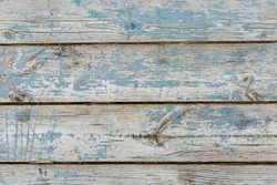 Aged light blue painted wood texture background. Old vintage wood board painted with blue paint. Weathered colored wooden planks of wall, fence, table or floor with copy space