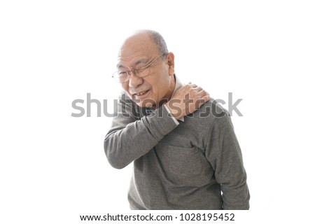 Aged man suffering from shoulder discomfort #1028195452